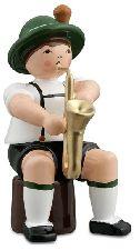 Bayernmusikant, sitzend mit Saxophon